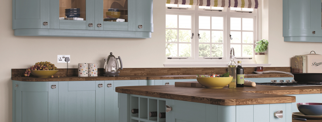 Country style kitchen with denim blue cupboard doors